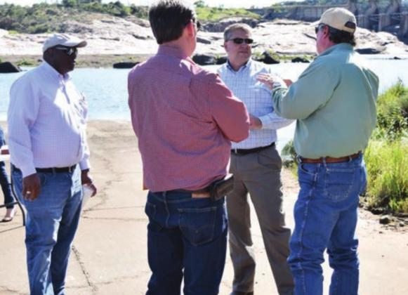 County and LCRA officials toured Wirtz Dam in 2017 and discussed a potential bridge crossing below the dam in Burnet County. On Tuesday, Aug. 25, the county signed a contract with KC Engineering to begin planning work on the Wirtz Dam Road project. File photo