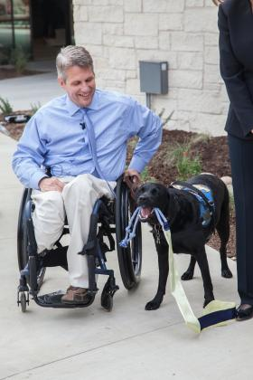 Baylor Scott and White Health, Texas' largest not-for-profit health system, has been recognized for disability inclusion. Retired U.S. Air Force Staff Sgt. Jason Morgan and service dog Rue assist with a ribbon cutting ceremony at Canine Companions for Independence at Baylor Scott and White Health – Kinkeade Campus. Contributed