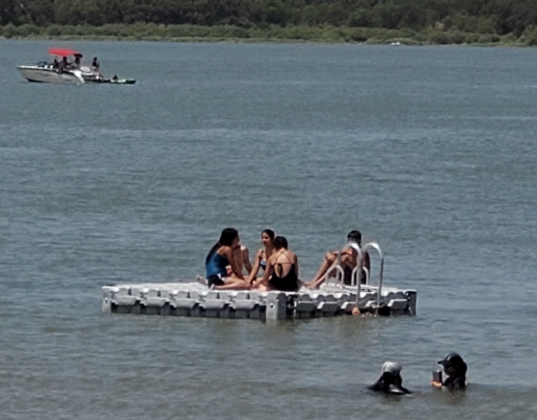 On July 19, visitors to Lake Buchanan soaked in the waterway to escape the heat. The thermometer surged past triple digits as early as 11 a.m. Lake Buchanan – which sometimes suffers in years of drought –  is considered 97 percent full. Connie Swinney/The Highlander