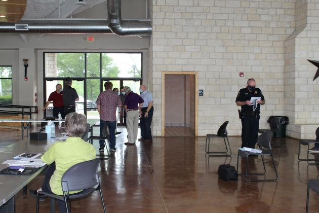 Back in May, Marble Falls City Council began hosting meetings (pictured here at Lakeside Pavilion) while social distancing and wearing face coverings. Despite an attempt by the council to encourage the wearing of masks but not require it with penalties for local businesses, Texas Governor Greg Abbott overrode local control of the mandate. File Photo