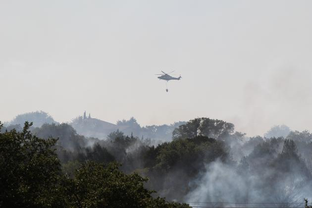 Firefighters from 18 fire departments, the Texas Forest Service, the Lower Colorado River Authority and Balcones Canyonlands National Wildlife Refuge battled a wildfire which consumed at least one home in The Trails at Horseshoe Bay and another in Blue Lake Thursday, Aug. 13.