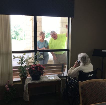 A couple visited recently with a loved one who is in the Granite Mesa Nursing Home in Marble Falls. The state is now allowing more leeway for one-one-one visits with health screening guidelines. File photo