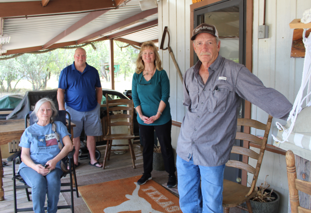 After about four months of operation, a group of Eagle Bluff residents have banned together to oppose the establishment of a shortterm rental home in their neighborhood. Pictured are: residents Scott Johnson (in back), Johnny Burkett, Kathy Bellamy and Sarah Byars (seated).