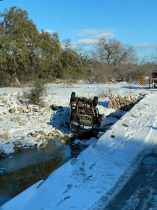 Early in the week, a vehicle overturned on CR 404 after succumbing to the snow-slicked roadway.