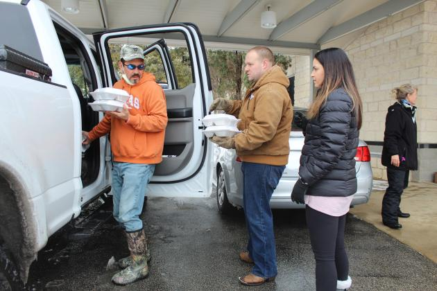 Highland Lakes Crisis Network volunteers Kevin (center) and Rachel Naumann and Rob Borchardt launched a food distribution effort for families in need. The group will continue serving food at 3 p.m. Friday, Feb. 19 at Marble Falls First United Methodist Church and at the Granite Shoals Police Department.