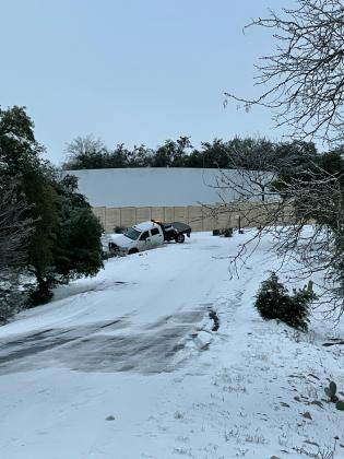 A utility vehicle contracting with Pedernales Electric Cooperative could not navigate the icy conditions and left the roadway on Clayton Nolen Drive in Horseshoe Bay.