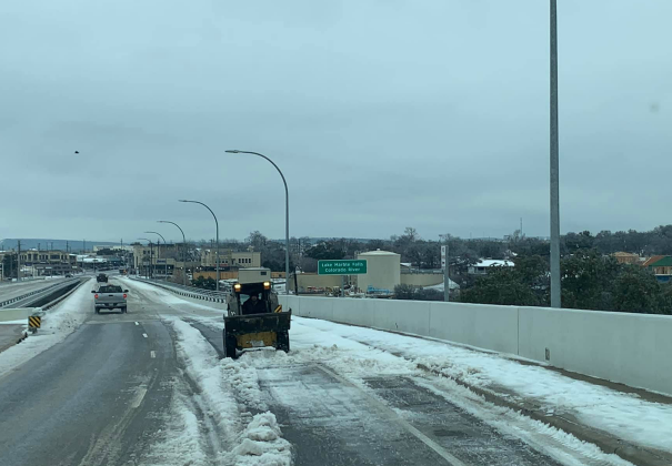 Two private citizens took it upon themselves to try to clear the way for safe travel on the US 281 bridge before authorities halted their activity and referred the de-icing duties to the Texas Department of Transportation.