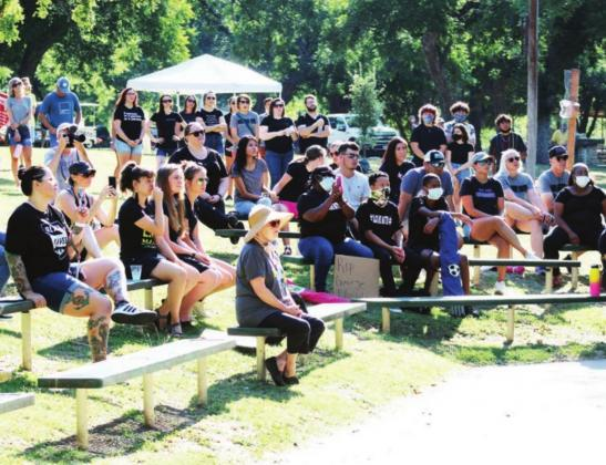 Left: A crowd of about 200 people including here at the pavilion seating area and the Backbone Creek side of Johnson Park attended the June 13 Black Lives Matter protest event in Marble Falls.