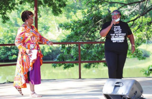 Above: A series of speakers, including faith-based community leaders spoke at the Black Lives Matter protest on Saturday at the pavilion stage adjacent to Backbone Creek in Johnson Park. Pictured are long-time resident Bessie Jackson (left) and Monique Breaux, who assisted a group of high school graduates with organizing the protest.