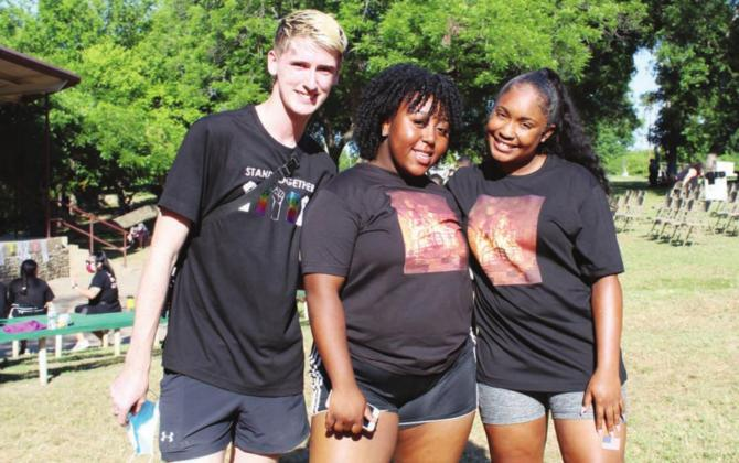 Local Black Lives Matter and 2020 Marble Falls High School graduates, from left, Bryce Laake, Shyann Brown and Mauri Harris co-organized the local event which featured speakers in Johnson Park and a protest March along Main Street.