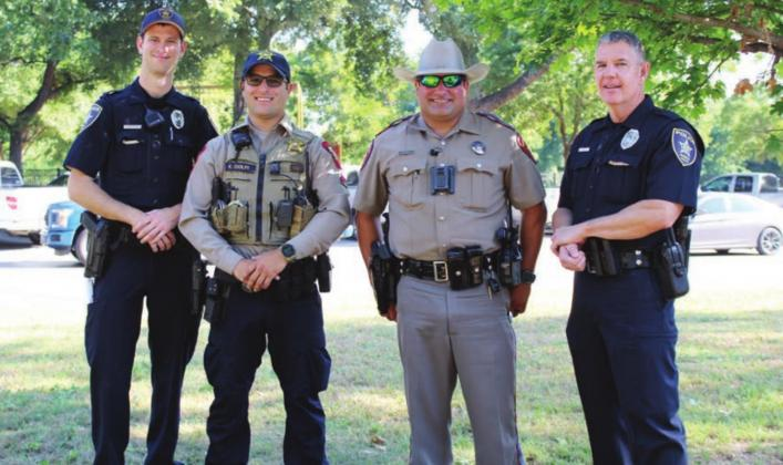 Above: Law enforcement from area agencies provided security for the protest event in Marble Falls on June 13. Pictured, from left, are: Marble Falls Police Officer Connor Du Coty; Burnet County Sherff's Office Deputy Kyle Ciolfi; Texas Department of Public Safety Trooper Steven Petrick; and Marble Falls Police Officer Max Johnson.