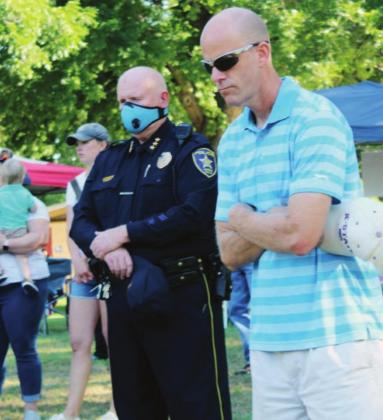 Left: Marble Falls Police Chief Mark Whitacre and Marble Falls ISD Superintendent Chris Allen attended the protest and march June 13 in Marble Falls.