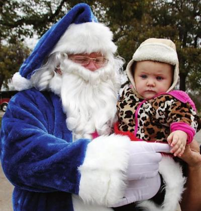 Blue Santa of Christmas' past have made public appearances such as Main Street Market Day to promote the donation program. File photo
