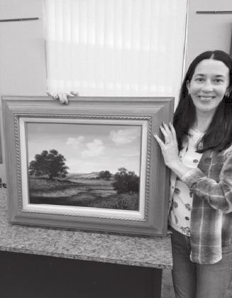 Melissa Brown is the lucky winner of a beautiful landscape painting by Peggy Cain at Highland Arts Guild & Gallery during the Fall Show drawing. Brown lives in McKinney, Texas. Contributed