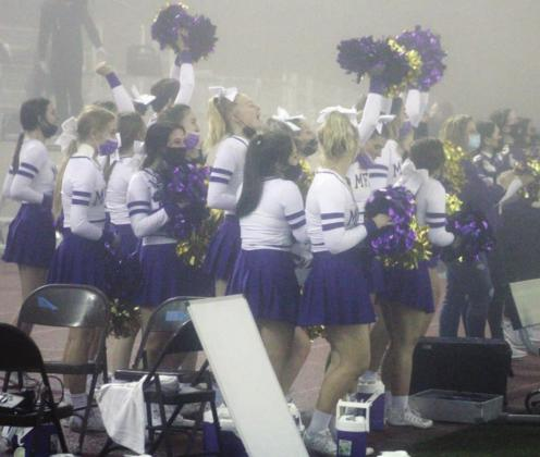 The Marble Falls cheer team, seen here in Brenham during the foggy football playoff game, will compete at the UIL State Spirit Championships on Wednesday, Jan. 13. Nathan Hendrix/The Highlander