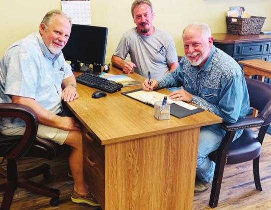 Local businessmen in the finance and trades industries are pooling their resources to replenish the Blue Collar Benevolence Fund to assist residents, struggling because of COVID-19 restrictions, lay-offs and closures. Pictured, from left, are: Tommy Salem, fund founder Brad Jackson and Raymond Whitman. Contributed